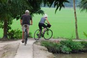 Family cycling the Mekong